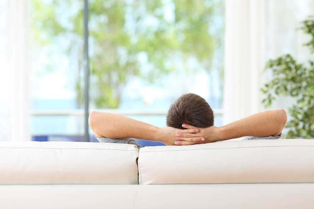 Man relaxing on sofa